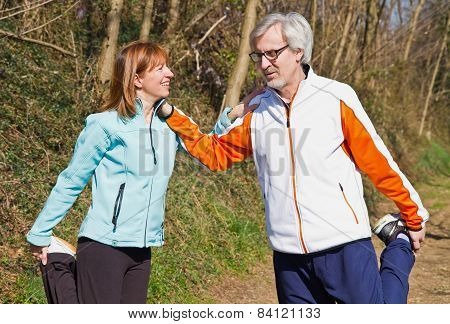 Senior Couple Doing Their Running Exercises.