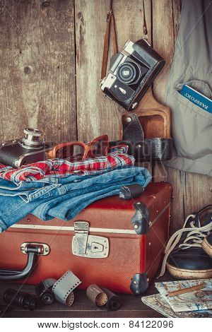 Old Travel Suitcase, Sneakers, Clothing, Sunglasses, Maps, Filmstrip And Retro Film Camera . Vintage