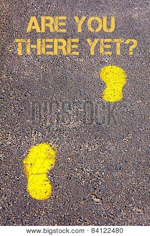 Yellow Footsteps On Sidewalk Towards Are We There Yet Message