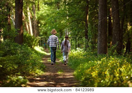 Boy With Girl Walking In The Summer Forest
