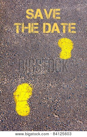 Yellow Footsteps On Sidewalk Towards Save The Date Message