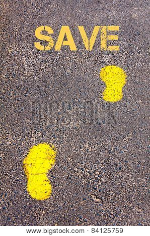Yellow Footsteps On Sidewalk Towards Save Message