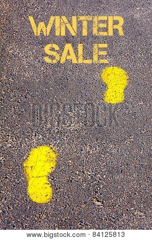 Yellow Footsteps On Sidewalk Towards Winter Sale Message