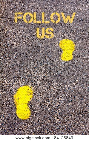 Yellow Footsteps On Sidewalk Towards Follow Us Message