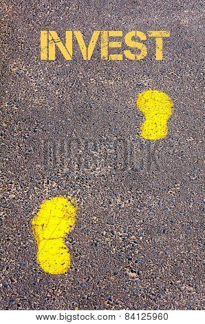 Yellow Footsteps On Sidewalk Towards Invest Message