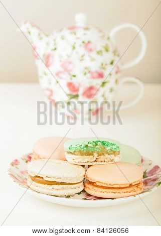 Traditional French sweets Macarons against tea set