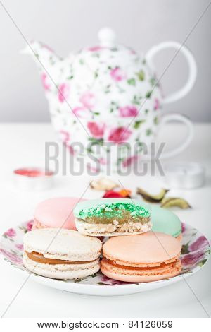 Traditional French sweets macarons with tea set