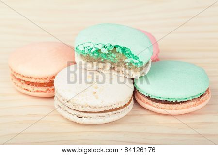 Traditional French sweets Macarons on wooden background