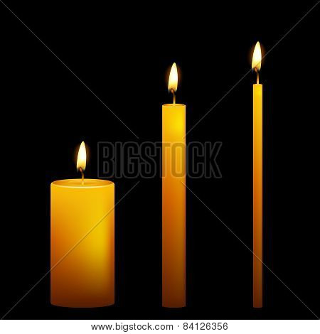 Set of three vector candles on dark background.
