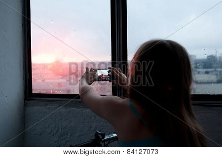 Girl Taking Photo Of Evening City