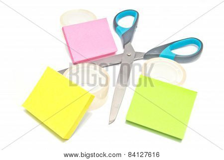 Scissors, Tape And Sticky Notes On White