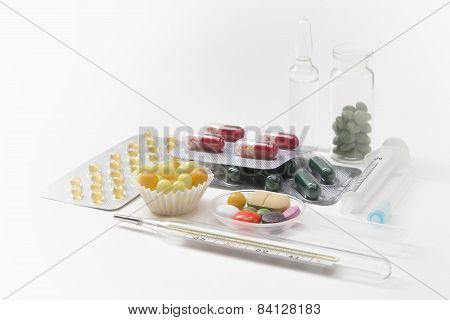Syringe, Thermometer, Tablets And Capsules In Blisters Isolated
