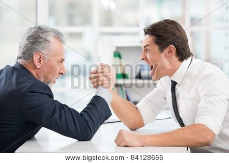 Two businessmen doing arm wrestling