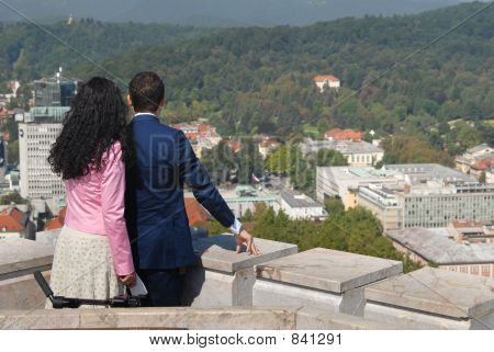 poster of Couple looking down on city