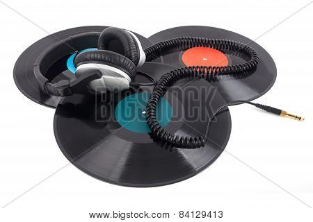 Headphones Lying Over Vinyl Record