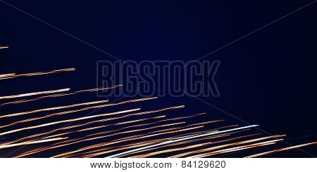 Abstract Light Trails In The Sky Photo - Toned Image. Night Photo With Retro Filter.