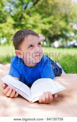 Boy Dreaming Under Book