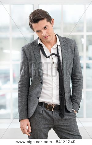 Portrait of young businessman with loosened tie