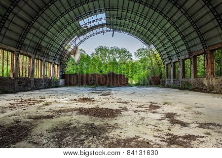 Abandoned Hangar In Forest