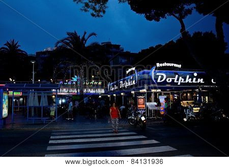 Night scene with neon lights and tourists