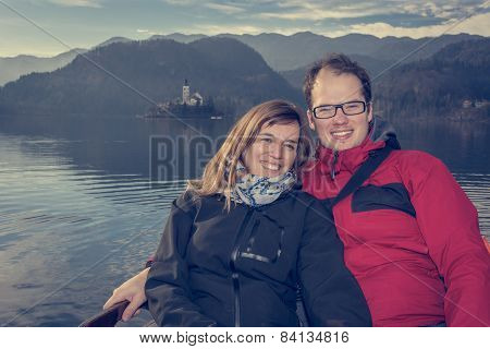 Happy Couple In A Boat.
