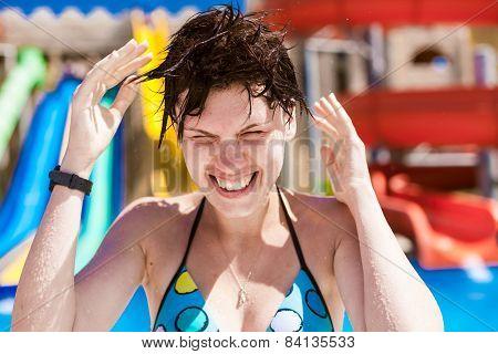 woman splashing water in the ocean