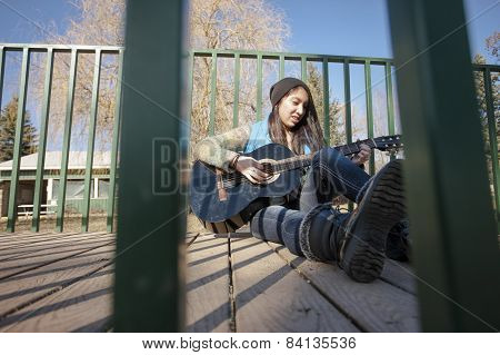 Musician Playing Guitar.