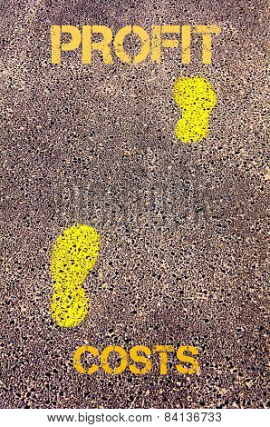 Yellow Footsteps On Sidewalk From Costs To Profit Message. Concept Image