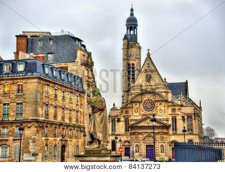 Statue Of Pierre Corneille And The Church Of Saint-etienne-du-mont In Paris