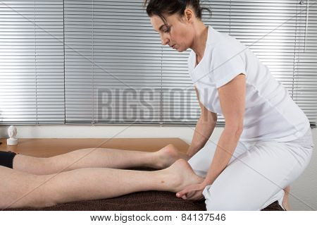 Shiatsu massage, at spa center , feet massage