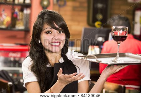 beautiful young waitress girl serving a drink