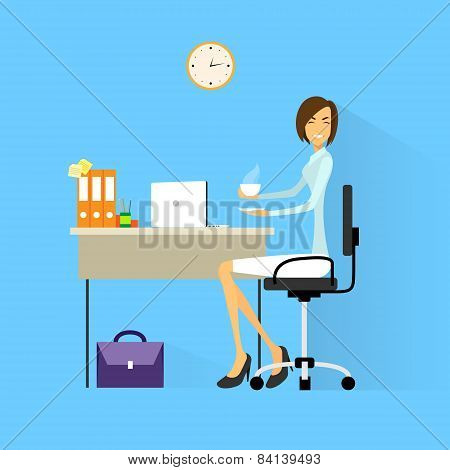 business woman drink coffee sitting at desk in office working laptop computer