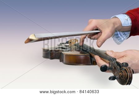 Man's Hands Holding Old Violin And A Bow