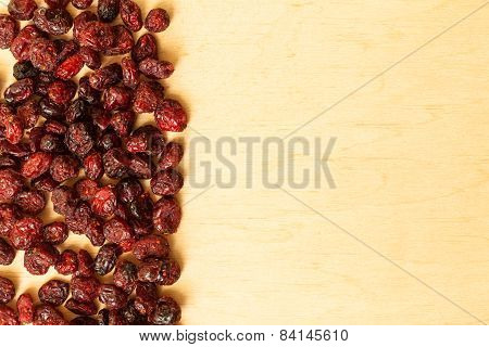 Border Frame Of Dried Cranberries On Wooden Background