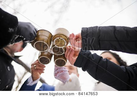 five friends toasting with hot drink winter