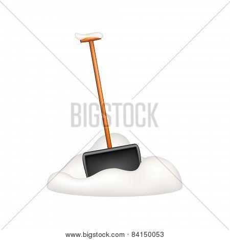 Black snow shovel standing in snow