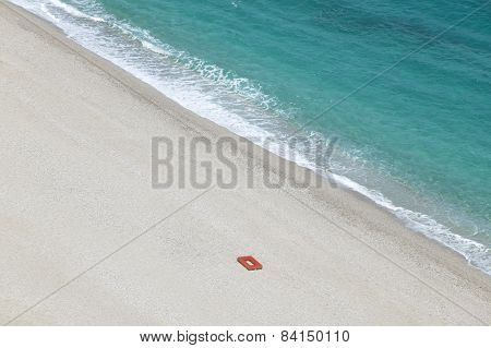 Mediterranean Beach With Red Life Ring In Almeria. Spain