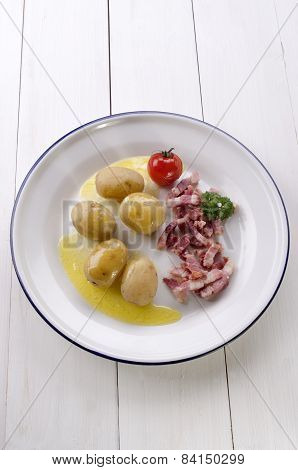 Boiled Potatoes With Fried Bacon And Tomato