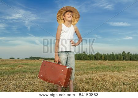 Laughing Teenage Hitchhiker In Countryside Field