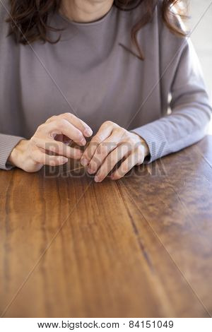 Woman Hands On Wooden Table