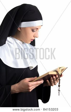 Young Beautiful Woman Nun With Bible And Rosary Isolated On White