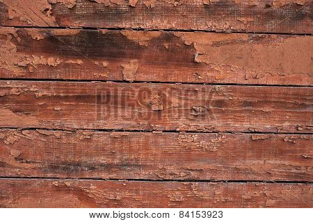 Close-up picture of wood wall. The wall is old and  with peeling paint