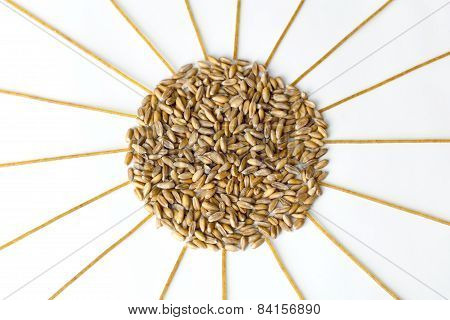 Heap Of Wheat Grains And Spaghetti In The Form Of The Sun On A White Background