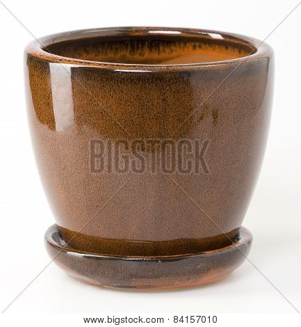Glazed Brown Ceramic Flowerpot With Saucer On White