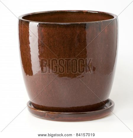 Glazed Red Brown Ceramic Flowerpot With Saucer On White