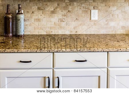 Granite Countertop And Tile Backsplash