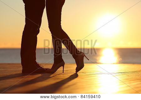 Couple Legs Falling In Love Hugging At Sunset