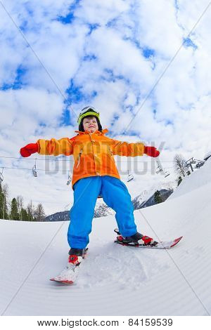 View from below of boy in ski mask skiing
