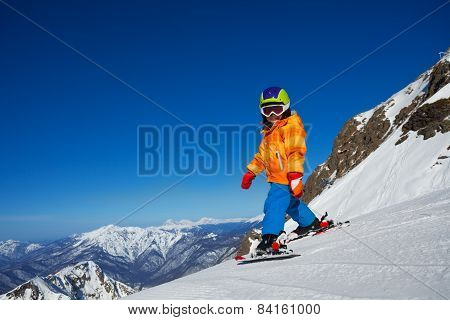 Boy skiing in winter with beautiful mountains
