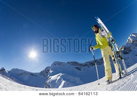 Fisheye view of woman holding ski with poles